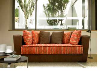 L nea de sillones axel en vivienda for Sofas y sillones a juego